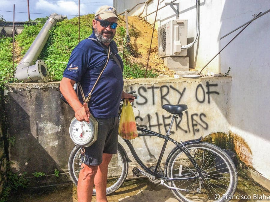 Francisco Blaha stands outside a fisheries office in the Pacific, with a bicycle for transport and manual scales to work with (Photo: Francisco Blaha)