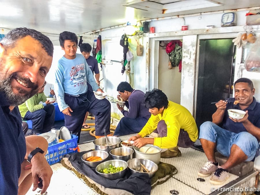 The crew breaks for lunch when Francisco (far left) is on board controlling transhipment at Noro, in the Solomon Islands. (Photo: Francisco Blaha)