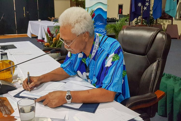The Honourable Marion Henry, Federated States of Micronesia, signs the SAP. Hon. Henry was the FFC Ministerial Chair at this meeting, and the representative of the host government.