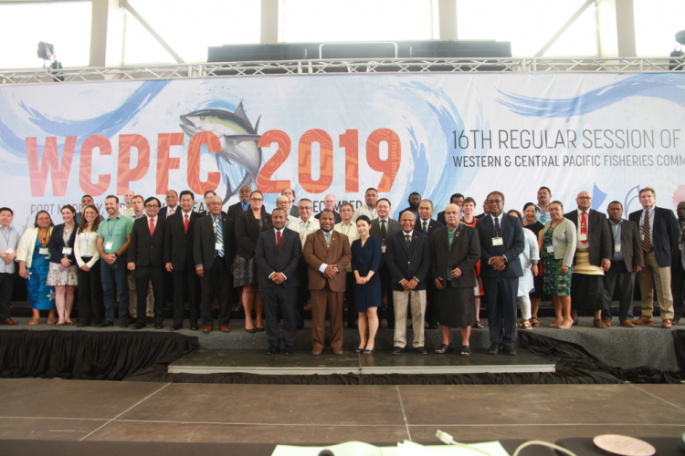 Group of people in front of banner for 16th regular session of the Western and Central Pacific Fisheries Commission (WCPFC16) 5 December 2019