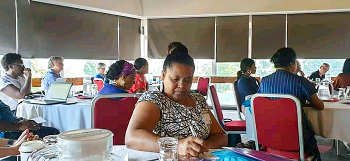 Solomon Islands government representative Rosalie Masu takes notes during the One Ocean Hub workshop. Photo: Dr Transform Aqorau.jpg