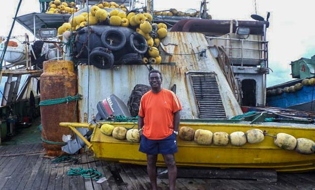 Dr Transform Aqorau on deck of a purse-seine fishing vessel. Photo: Giff Johnson.