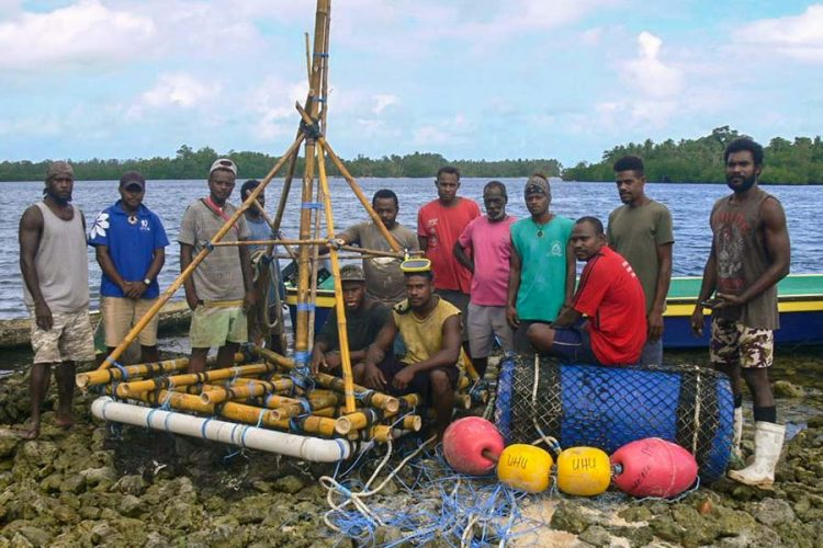 Group of Solomon Islands men of Uhu in West Are'are, Malaita Province, prepare to put a FAD to sea. It is to help maintain livelihoods during COVID-19 restrictions. Photo by Mathew Isihanua.