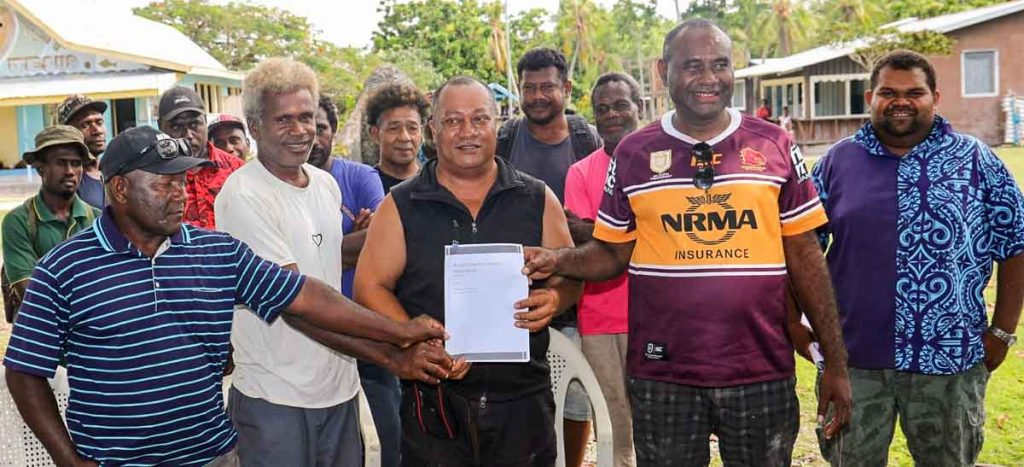 Group of men at formal signing up of Russell Islands Fisheries Association, Solomon Islands. In the photo are unidentified members of the association and Savo-Russells MP Dickson Mua and Central Islands Province Premier Stanley Manetiva. Photo: Solomon Islands Government Communications Unit.