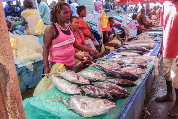 Women at market stalls sell fish at Honiara Central Market, Solomon Islands. Photo Ronald Toito'ona.