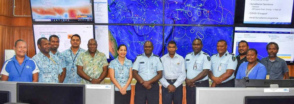 Executive officers of the RSIPF, FFA Director-General, Dr Manumatavai Tupou-Roosen (6th from left), FFA Director Fisheries Operations, Allan Rahari (7th from left), and FFA RFSC staff inside the surveillance centre. Photo: RSIPF Media Unit.