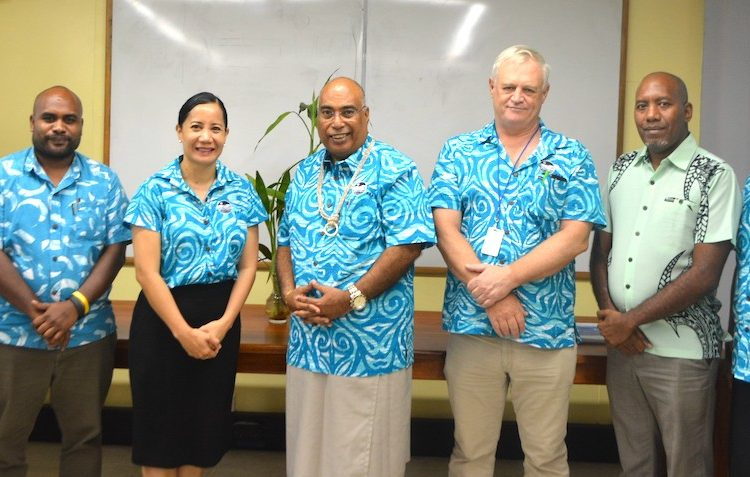 Dr Tupou-Roosen and members of the FFA Executive with Mr Beck and his team