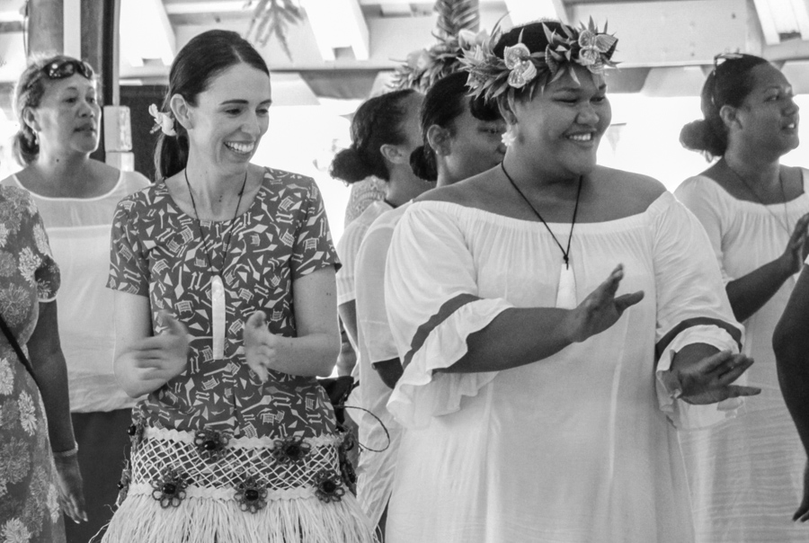 New Zealand Prime Minister Jacinda Ardern (left) learns steps of a traditional dance from Tokelau's Te Kaumana'alofa (right) during official visit to Tokelau in July 2019. Photo: Fatu Tauafiafi/Pacific Guardians.