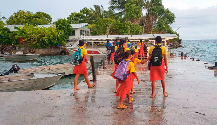 Students of Tialeniu School make their way to the school shuttle to take them across the lagoon to Fenuafala where the school is located. Photo: Litia Maiava/Te Mana.