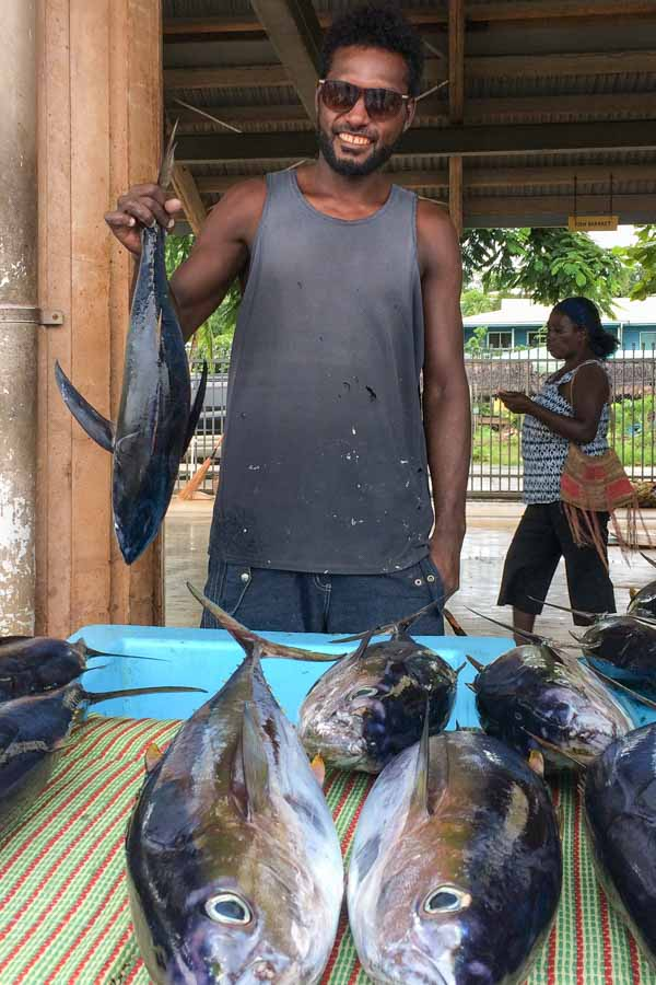 Wesley Misu sells his tuna catches at the Gizo Fish Market, Solomon Islands. Photo George J Maelagi.
