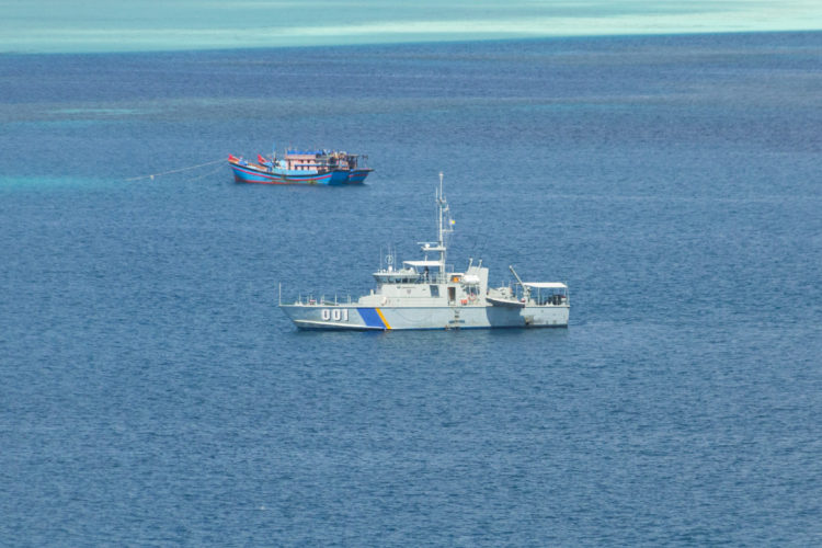 Palau's lone patrol boat PSS Remeliik apprehends two Vietnamese blue boats fishing illegally at Helen Reef in 2015. Photo: Richard Brooks.