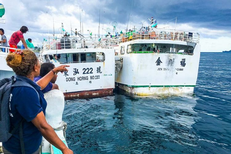 Female compliance officer and two longline fishing vessels Solomon Islands. Photo Francisco Blaha.