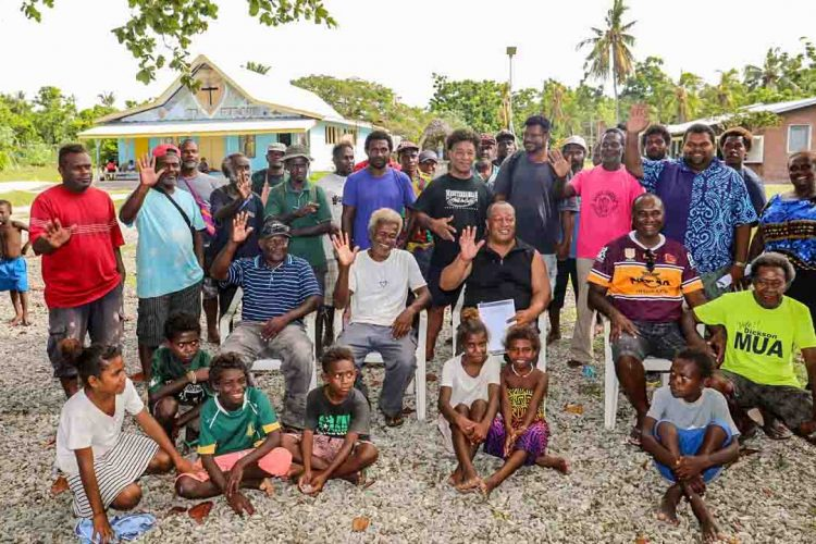 Members and families of newly formed Russell Islands Fisheries Assocation, on a beach in Solomon Islands. Photo: Solomon Islands Government Communications Unit.