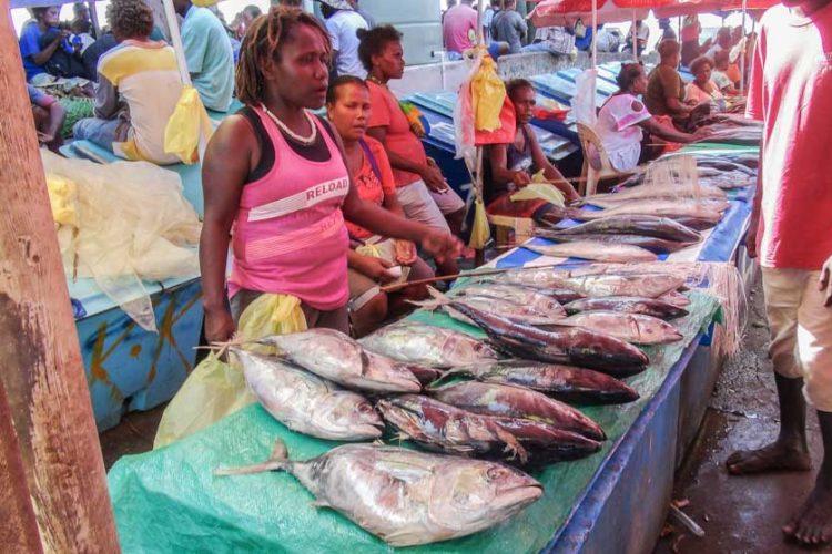 Women at market stalls sell fish at Honiara Central Market, Solomon Islands. Photo Ronald Toito'ona.