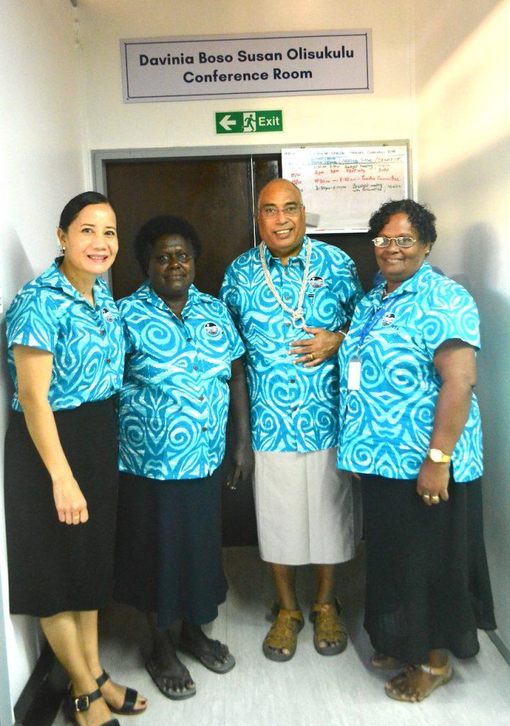 The FFA Director-General, Dr Dr Tupou-Roosen (left) and His Excellency, Collin Beck (second right), with the two longest-serving staff of the FFA, Solomon Islands nationals Mrs Susan Olisukulu (second left) and Davinia Boso (right), in front of the FFA conference room named in their honour earlier this year.