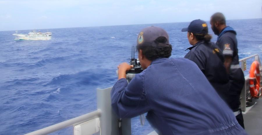 Officers on the Fijian patrol vessel RFNS Savenaca assessing a fishing contact during Operation Kurukuru. Photo: Fiji NHQ.