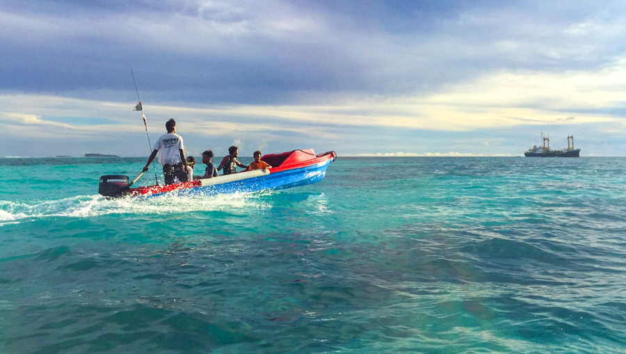 Small speedboat moving through shallow atoll waters. Small outboards like this are the only means of transport between the islands of Ontong Java. Photo: Iggy Pacanowski.
