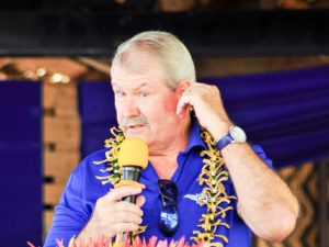 Russell Dunham, of the Tuna Industry Association of Solomon Islands, talking into a microphone. Photo: Ronald F. Toito'ona.