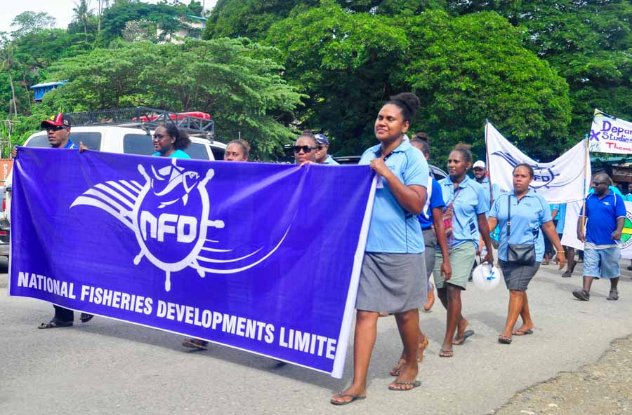 Officers of the National Fisheries Development take part in the parade in Honiara to mark World Tuna Day 2021. Photo: Ronald F. Toito'ona.