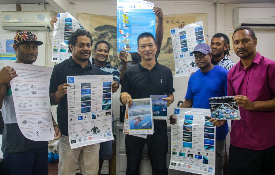 Sunshine Fisheries crew with their General Manager, Darren Zhang, receive their bycatch awareness materials for fishing vessels. Photo: WWF-Pacific/Ravai Vafo'ou.